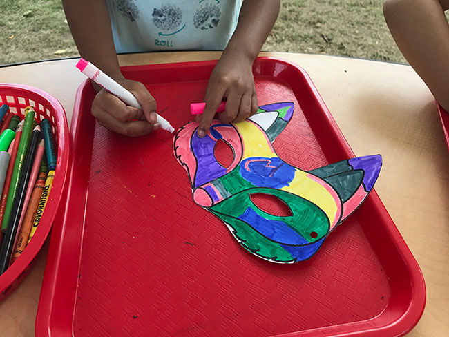 Drawing masks at The Minnesota State Fair's Alphabet Forest